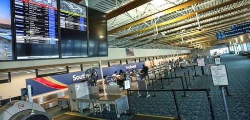 Passengers check in at the Southwest Airlines counter