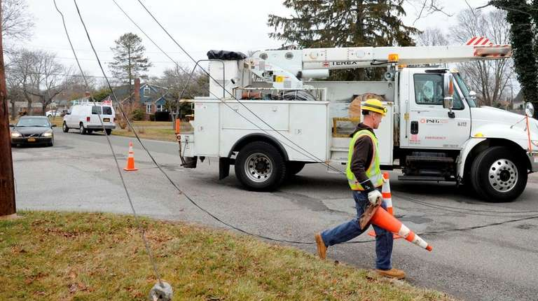 A PSEG worker at the scene of downed
