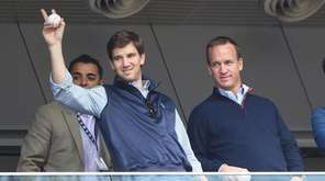 Eli Manning of the Giants and Peyton Manning