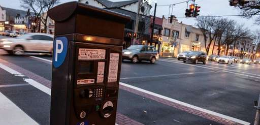 An electronic parking meter at the corner of