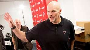 Atlanta Falcons head coach Dan Quinn leaves a