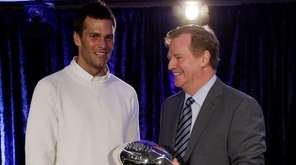 New England Patriots quarterback Tom Brady poses with
