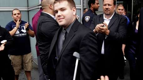 NYPD Officer Richard Haste leaves court in 2012
