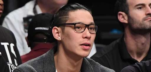 Brooklyn Nets guard Jeremy Lin looks on from