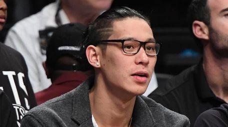Brooklyn Nets guard Jeremy Lin looks on from