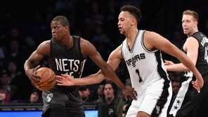 Brooklyn Nets guard Isaiah Whitehead spins with the