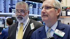 Traders Kenneth Polcari, left, and Christopher Fuchs work