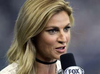 FOX Sports sideline reporter Erin Andrews works during