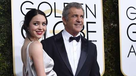 Rosalind Ross and Mel Gibson arrive for the