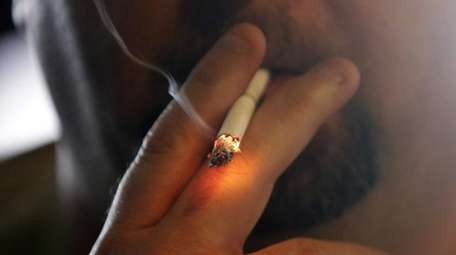 A man smokes a cigarette in New Orleans,