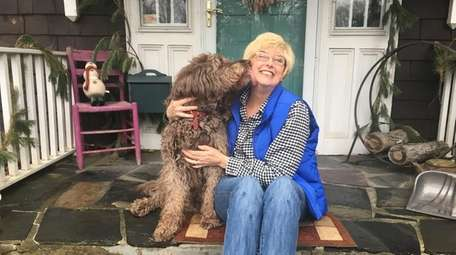 Laura Houston Neville with Maggie, the family Labradoodle.