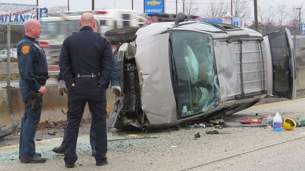 Suffolk County police investigate a the scene of
