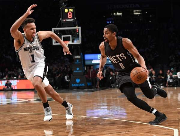 Brooklyn Nets guard Spencer Dinwiddie drives against San