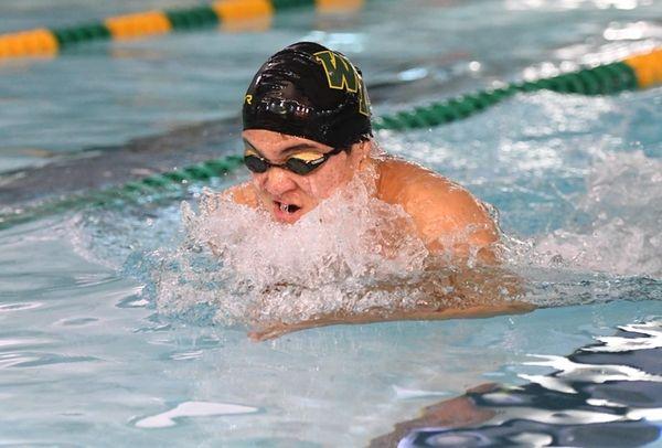 David He of Ward Melville swims breaststroke in