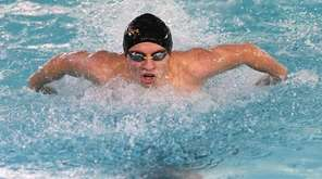 Cameron Kubik of Ward Melville swims the 100