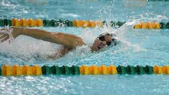 Gregory Logan of Ward Melville swims the 200