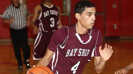Bay Shore's Jose Rivera (4) moves the ball