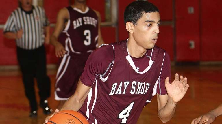 Bay Shore's Jose Rivera (4) moves the ball