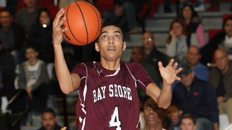 Bay Shore's Jose Rivera (4) scores in the