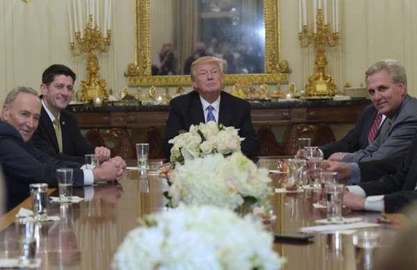 President Donald Trump, center, hosts a reception for