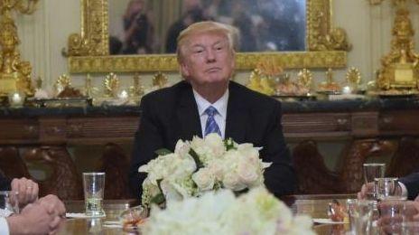 President Donald Trump, center, hosts a reception for