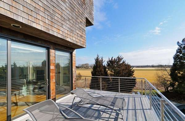 This 6,800-square-foot Contemporary shingle-style residence in Sagaponack is