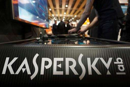 A Kaspersky employee shuffles tokens around a table-top