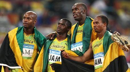 From left, Jamaica's Asafa Powell, Nesta Carter, Usain