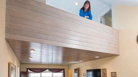 Lesa Dresher standing in a loft-like area of