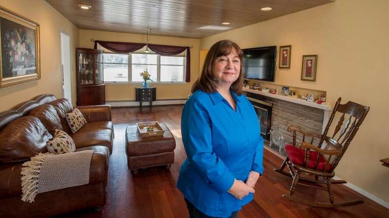 Lesa Dresher shows the living room of her