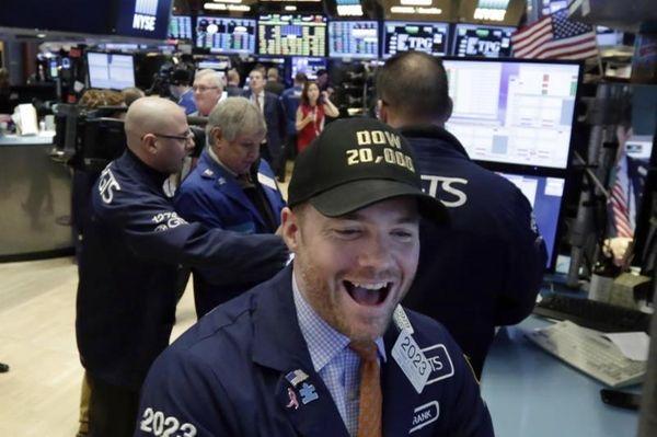 Specialist Frank Masiello wears a Dow 20,000 cap