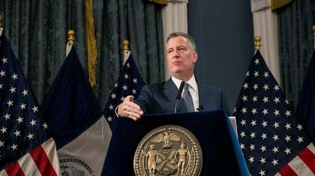 New York City Mayor Bill de Blasio presents