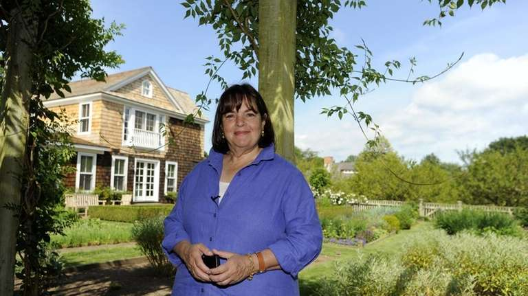 Ina Garten, the Food Network's Barefoot Contessa, stands