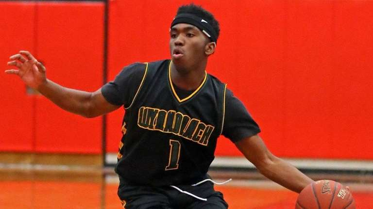 Wyandanch's Kashawn Charles moves the ball upcourt during