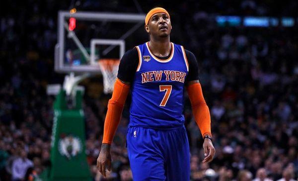 New York Knicks forward Carmelo Anthony walks up