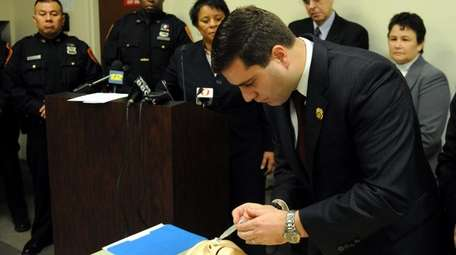 Suffolk County Police Commissioner Timothy Sini demonstrates the