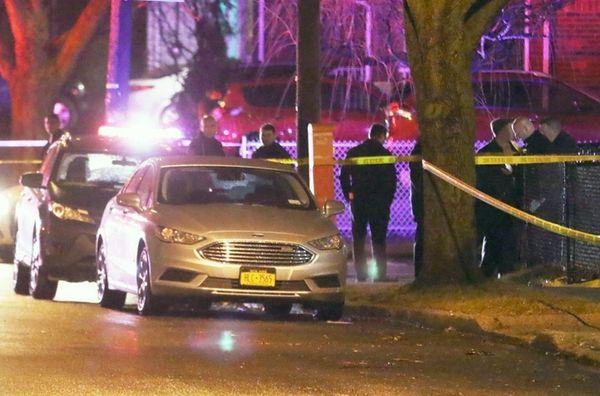 Police investigate the scene of a double homicide