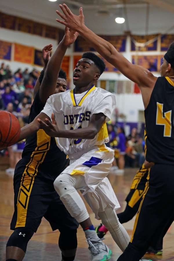 Greenport's Ahkee Anderson #13 splits the defense and