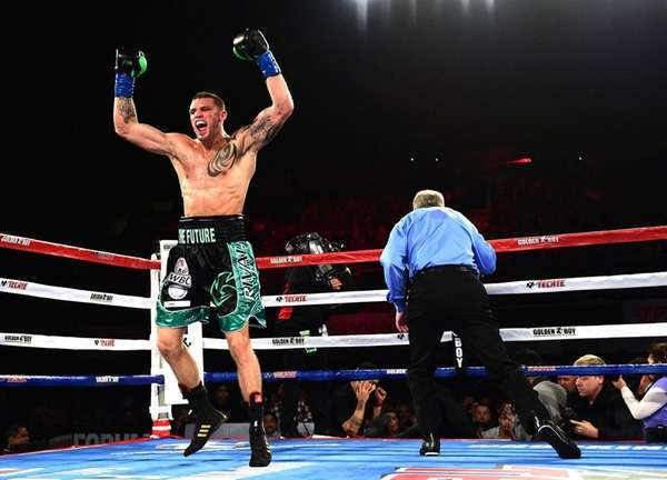 Joe Smith Jr. reacts after punching Bernard Hopkins