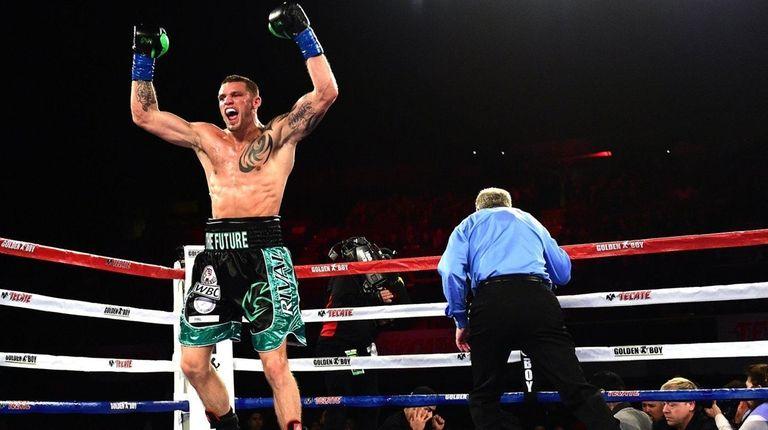 Joe Smith Jr. reacts after punching Bernard Hopkins