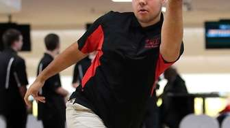 Patchogue-Medford's Jake Scala bowls during a match at