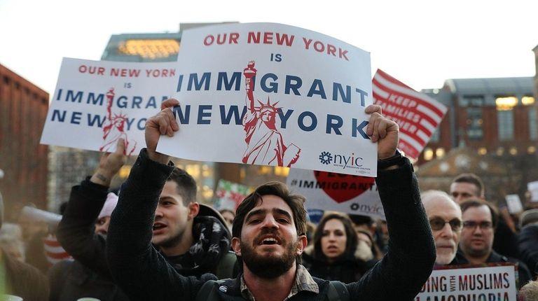 Hundreds attend an evening rally Wednesday, Jan.