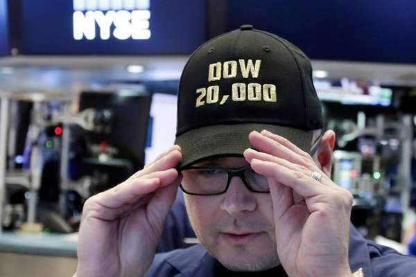 Specialist Mario Picone adjusts his Dow 20,000 cap