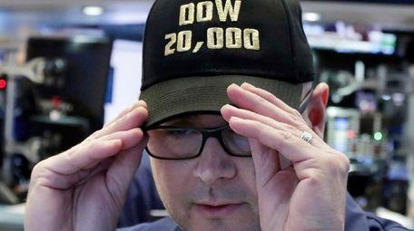 Specialist Mario Picone adjusts his Dow 20,000 cap