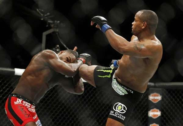 Daniel Cormier kicks Anthony Johnson during their light