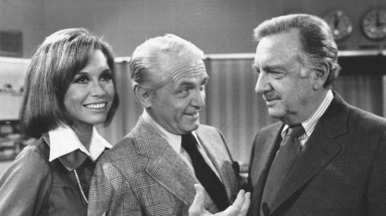 TV news commentator Walter Cronkite, right, meets with