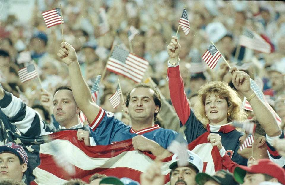 Fans show their patriotic spirit during opening ceremonies