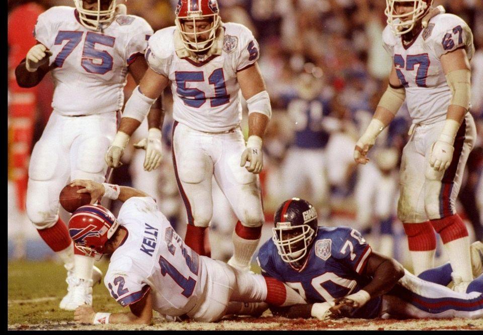 Quarterback Jim Kelly of the Buffalo Bills gets