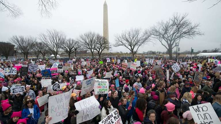 Crowds of people descend on the National Mall