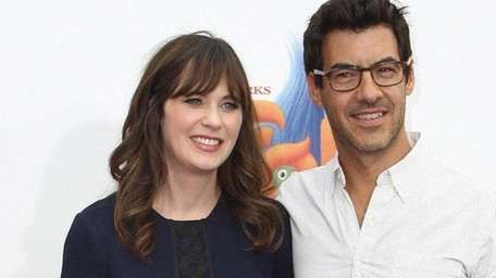 Zooey Deschanel and husband Jacob Pechenik, above in
